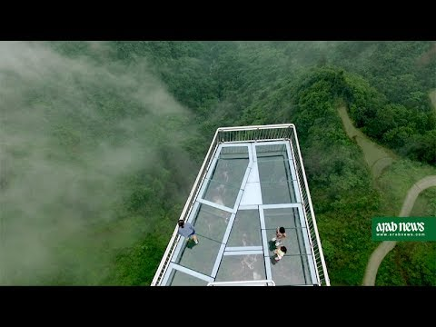 Don't look down  glass bottom skywalk thrills in China