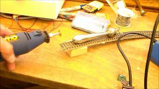 Cutting model train layout track with Dremel tool