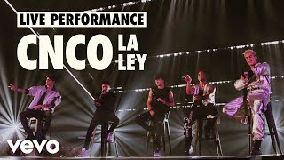 "CNCO – La Ley (Official Live Performance) | Vevo LIFT  As part of their LIFT campaign, we hung with the superstar Latin squad and captured killer performances of ""Pretend,"" ""De Cero"" and ""La Ley."" And they discussed their music and career in our exclusive profile. Watch 'em all, and be sure to share 'em with other CNCO fans.   Watch the official video for ""Pretend"": http://bit.ly/2JuDQUZ  Watch CNCO's LIFT profile: https://youtu.be/Ic3ytDS_Qto  Watch CNCO music videos: http://bit.ly/2PWUjm9  Música Disponible/Available Music:  Spotify: https://smarturl.it/QQS/spotify Apple Music: https://smarturl.it/QQS/applemusic Amazon Music: https://smarturl.it/QQS/az iTunes: https://smarturl.it/QQS/itunes Google Play: https://smarturl.it/QQS/googleplay   Redes/Socials   Official Site: http://www.cncomusic.com Facebook: https://www.facebook.com/CNCOmusic Twitter: https://twitter.com/CNCOmusic Instagram: https://www.instagram.com/CNCOmusic Snapchat: http://www.snapchat.com/add/CNCOmusic  Vevo http://www.facebook.com/Vevo http://www.twitter.com/Vevo http://instagram.com/Vevo  Executive Producer: Micah Bickham Director: Micah Bickham Producer: Maura Scully  Producer: Saharah Sejour  Producer: Hailey Rovner  Editor: Ramy Elsokary Music & Talent: Gabby Prisciandaro, Julie Fernandez  #CNCO #LaLey #QQS #VevoLIFT   http://vevo.ly/3KJk71"