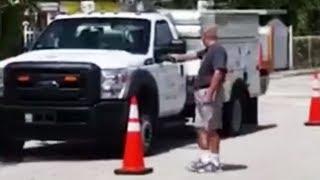 Man Loses It, Unloads Gun Into Utility Truck (VIDEO)