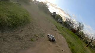 Team Associated SC10 chased by FPV Racing Drone