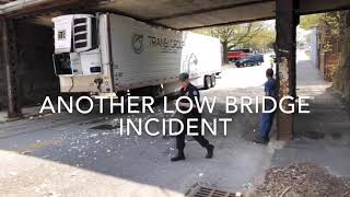 Truck hits railroad overpass on Webster Street in Worcester