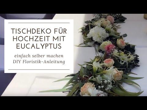 Tischdeko mit Blüten in Schlangenlinien und Eucalyptus DIY für Hochzeit und Events