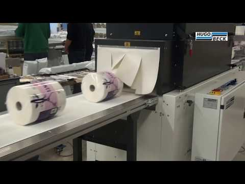 Shrink wrapping of tissue rolls in printed film
