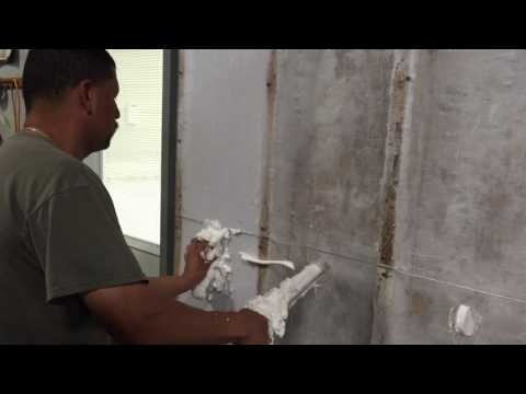 Injecting an open cavity with Pre-expanded Injection Foam Insulation.