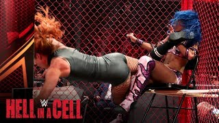 Becky Lynch hits Sasha Banks with a Hellish dropkick: Hell in a Cell 2019