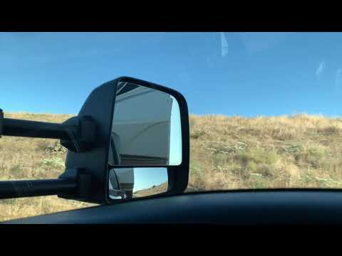 Nissan Titan Xd pulling a 5th wheel up some grades going to Pismo Beach Oceano  dunes.
