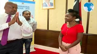 Health CS Mutahi Kagwe shares a light moment with Brenda and Brian.