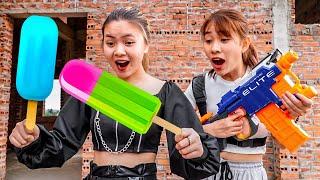 Action Nerf War: Couple Beautiful Girl Nerf Guns Dispute Fruit ICE CREAM BATTLE