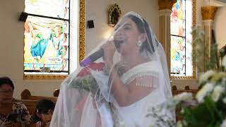 Bride, singing Ikaw by Yeng while walking down the aisle.