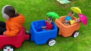 Ride on Wagon with baby dolls and Umbrellas