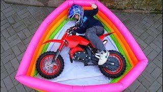 Funny Video For Children Baby Ride on Dirt Cross Bike Power Wheel Pocket Magic Hide and Seek Pool