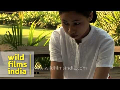 Woman gives body massage to a tourist at a resort - Goa