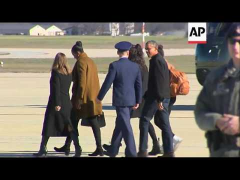 Obama Family Arrives Home from Holidays