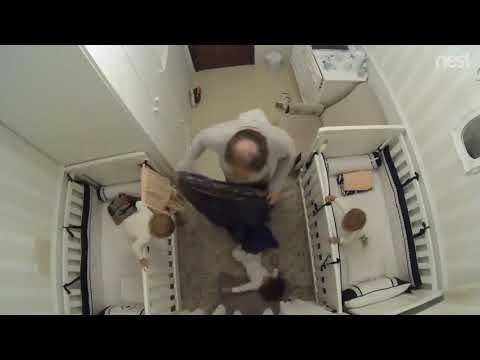 Dad Saves Baby From Falling Out of Crib - 985558