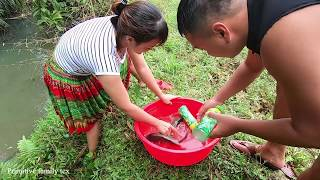 Primitive family: fishing with a soda bottle