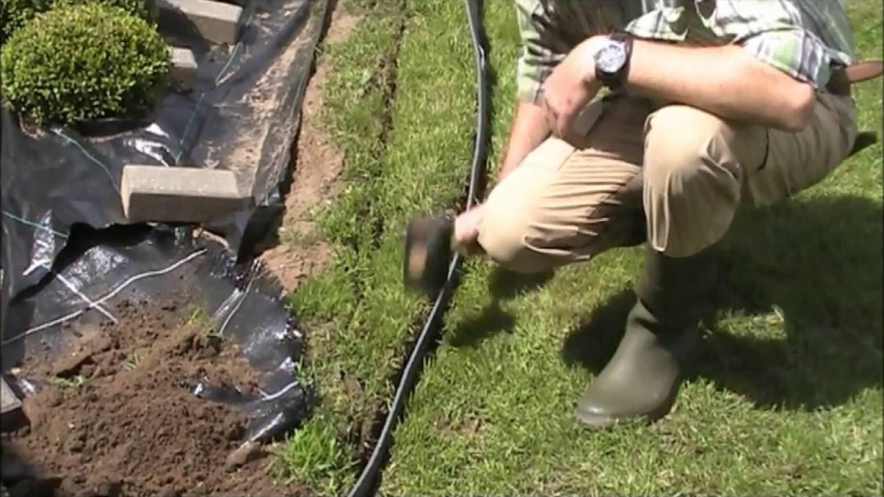 Plaatsing Ecolat voor afboording in de tuin