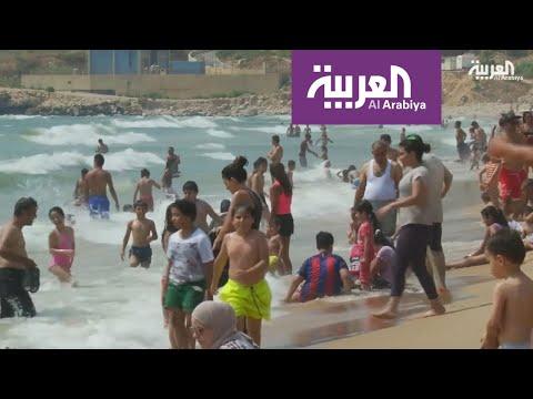 العرب اليوم - شاهد: سباحة رغم المياه العادمة في لبنان