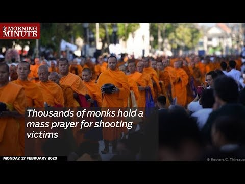 Thousands of monks hold a mass prayer for shooting victims