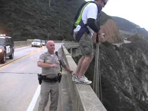 Crazy Guy BASE Jumps Off A Bridge To Evade Police Arrest