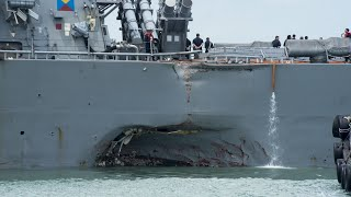 US Navy warship collides with oil tanker