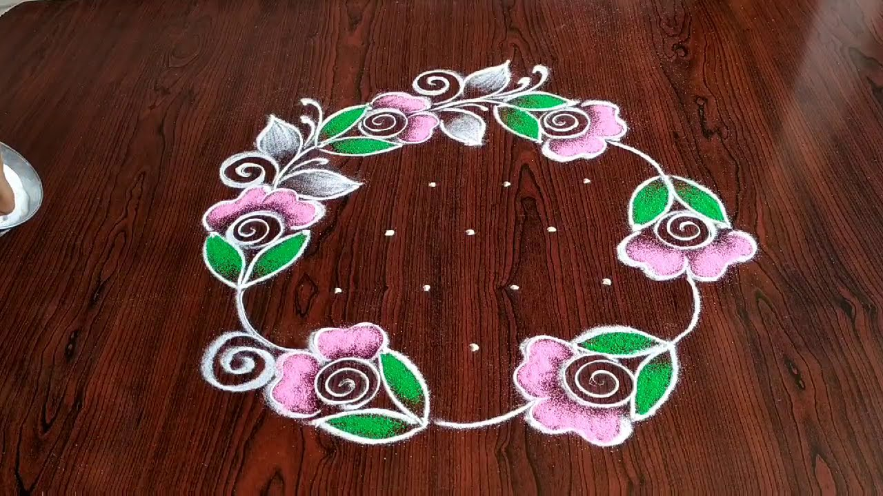 dotted rangoli design wreath of roses by sresta rangoli