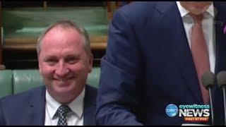 Barnaby Joyce smirks as Malcolm Turnbull announces his leave