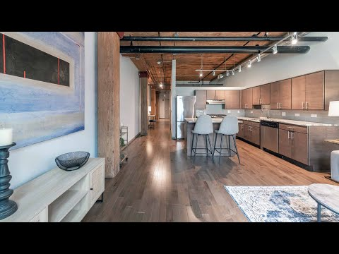 A spacious Streeterville one-bedroom model at The Lofts at River East