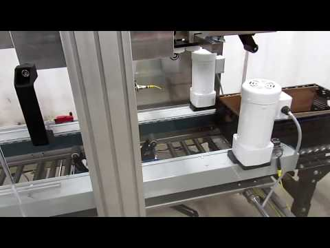 Selladora Random TBS-100FC XL con sensor para desviar canastas plásticas