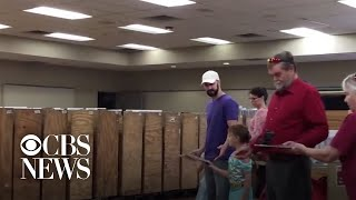 Hundreds Of Volunteers Help Move Books From Old Library