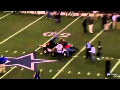 An unmanned, electric golf cart ploughed into a crowd at a football game, injuring the head coach and several supporters. The incident happened during celebrations at the end of the high school championship football game after Spring Dekaney beat Cibolo Steele at the Cowboys Stadium in Arlington, Texas.   Spring Dekaney head coach Willie Amendola was in the middle of an interview when the cart knocked him and several bystanders to the ground.  Emergency services said that one man was taken to hospital with a leg injury.   Several others were hit by the cart but released by medical staff after being checked out at the stadium.   Spring Dekaney, from Harris County, Texas, beat Cibolo Steele 34-14 during the Class 5A Divison II state championships. TV cameras showed a stunned Amendola falling backwards into the passenger seat of the golf cart as he tried to   One sports commentator said: 'We have a disturbance down the field. Apparently one of the carts on the field got loose and I think there have been some folks injured in this.   'That's like a runaway cart there. And it finally took someone to stop it. That's a scary thing.' It was unclear how the vehicle got loose. Stadium workers had been picking up fluorescent orange sideline yard markers and pylons after the game when the cart unexpectedly took off.