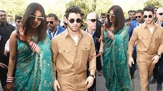 Priyanka Chopra Looks Royal In Mangalsutra And Sindhoor Avatar With Nick Jonas At Jodhpur Airport Priyanka Chopra Nick Jonas wedding Photos: Newlyweds are completely smitten by each other at Jodhpur airport Priyanka Chopra and Nick Jonas are now heading to the capital city from the Jodhpur and we have got the first pictures of the two as a married couple.   Priyanka Chopra and Nick Jonas are officially married. The two got hitched in two ceremonies - Christian and Hindu. PeeCee and Nick are now all set to host a lavish reception in Delhi. The newlyweds are now heading to the capital city from the Jodhpur and we have got the first pictures of the two as a married couple. Nick can't take eyes off his new bride Priyanka. Well, we can say that Cupid has done the job and they are completely lovestruck in these photos. We are gushing after seeing the two of them together holding hands.   Priyanka Chopra sports a green saree. She completed her bridal look with red and white choodas and showed off her mangalsutra. Cat eye sunglasses and golden stilettos were the perfect accessories for her look. Nick, on the other hand, complemented his new wife by wearing a khakee coloured trousers and jacket. He paired it with a white tee, sneaker and black shades.   Your friend that serves entertainment on the platter with daily dose of Lifestyle hacks, Fashion tips and Bollywood spice. Safe for daily consumption!!