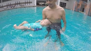 5 month old swimming baby