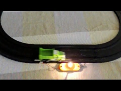 Homemade Tyco slot car contact track turning a light on when the car is passing