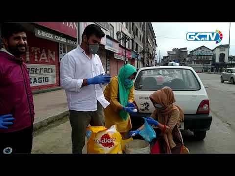 Covid-19 pandemic: Volunteers feed stray dogs in Kashmir