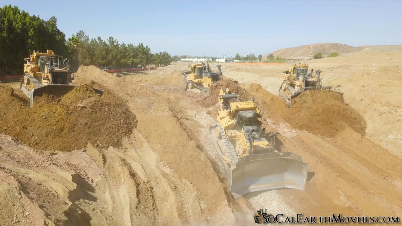 Serious Horsepower – A D10T and three D11T dozers grading for new building pad