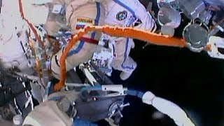 Russian cosmonauts step out into space