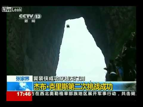 Jeb Corliss flies through the Tianmen Cave in China.