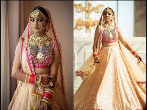 This bride wore a gorgeous golden and pink Anita Dongre lehenga!