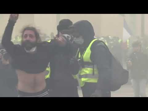 Paris police deployed tear gas and a water cannon as yellow-vested protesters took to the streets on Saturday. (Dec. 8)