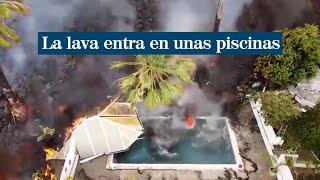 La lava entra en unas piscinas y provoca una densa columna de humo