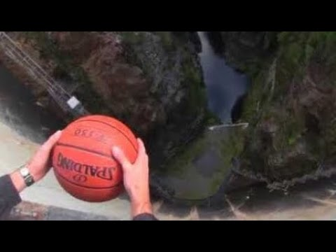 What Happens When A Spinning Basketball Is Thrown Off A Dam!