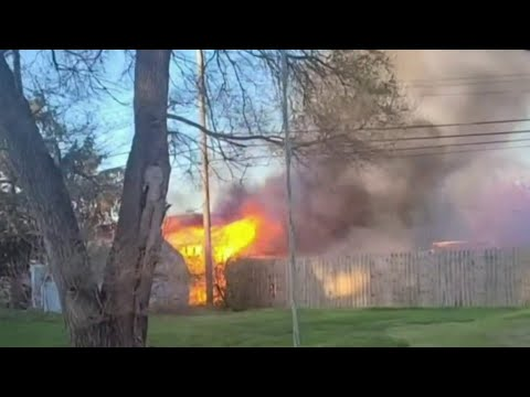 Carport with several propane tanks inside catches fire in Commerce Township