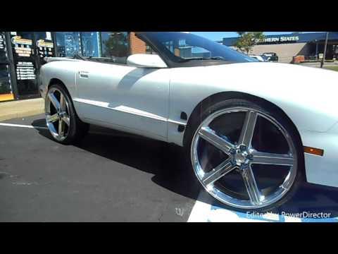 "2000 Pontiac Firebird sitting on 26"" 652 IROC Chrome wheels on 255/30/26 tires."