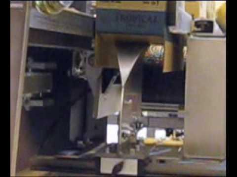 Cierre rotativo de solapas para cajas angostas