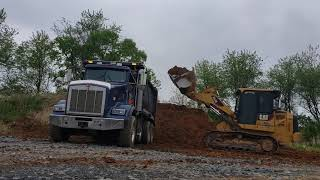 953 d cat track loader operator loading trucks