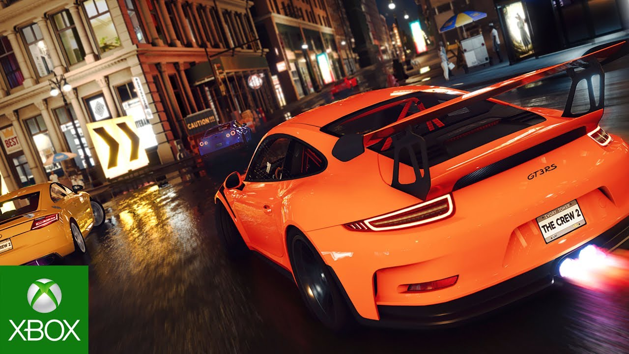 Back of Orange Porsche GT3RS in a street race