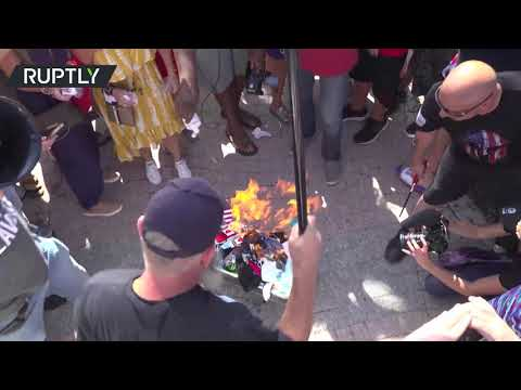 Florida protesters burn face masks during rally against COVID measures