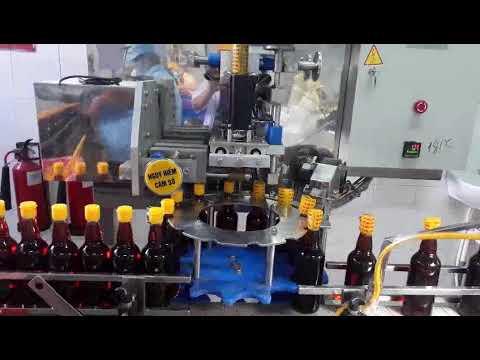 Máy màng co nắp chai
