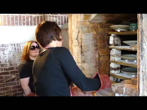 Virginia Scotchie and Bri Kinard unloading a kiln